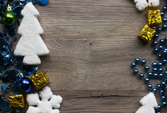 Holiday decorations closeup on wooden background with space for text. Royalty Free Stock Photography