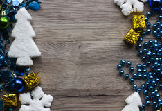 Holiday decorations closeup on wooden background with space for text. Stock Image
