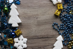 Holiday decorations closeup on wooden background with space for text. Stock Photography
