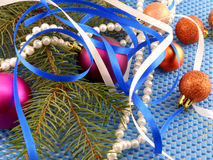 Holiday decorations: gifts, pearls, tree branch and christmas ball Royalty Free Stock Image