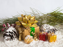 Holiday Decorations with Gold Present Stock Image