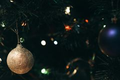 Holiday decorations hang on a Christmas tree stock images