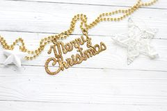 Holiday decorations and inscription: Merry Christmas stock photo