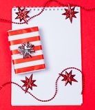 Holiday decorations and notebook and gift Royalty Free Stock Image