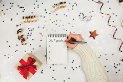 Holiday decorations and notebook with 2017 goals Stock Images