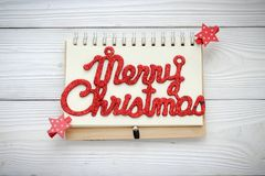 Holiday decorations and notebook with text: Merry Cristmas Royalty Free Stock Photo