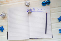 holiday decorations and notebook with to do list on white vintag stock photography