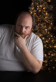 Holiday Depression. Middle-aged man dealing with seasonal depression Royalty Free Stock Photos