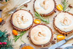 Holiday Dessert, Tartlets with Raspberries, Lemon Curd and Meringue, Christmas Background Stock Photo