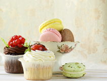 Holiday desserts, cupcakes and macaroons Stock Images
