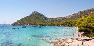 Playa de Formentor in Majorca, Spain. 29 July 2017 - Majorca, Spain. Popular holiday destination island in Europe. Sunbathers enjoying hot summer day on Playa Stock Photos