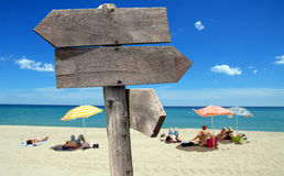 Holiday destination. Signs of direction on the beach Stock Photo