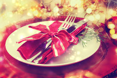 Holiday Dinner Plate Setting. Red and gold themed holiday dinner table plate setting Royalty Free Stock Photo