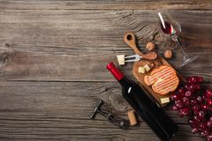 Holiday Dinner setting with red wine and creaming cheese on rustic wood. Top view with space for your greetings royalty free stock images