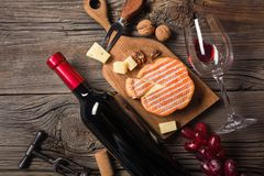 Holiday Dinner setting with red wine and creaming cheese on rustic wood. Top view with space for your greetings royalty free stock photos