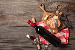 Holiday Dinner setting with red wine and creaming cheese on rustic wood stock photos