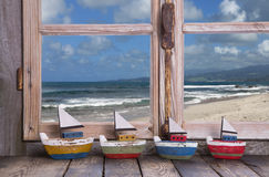 Holiday dreams - wooden window with sea view Stock Photos