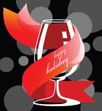 Holiday drink glass. Empty isolated wine glass with holiday slip on a colourful background Royalty Free Stock Image