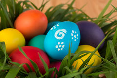 holiday Easter eggs in basket with grass Stock Image