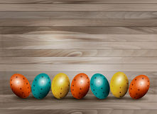 Holiday Easter eggs on wooden background. Stock Image