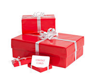 Holiday economy. Three gift boxes with a blank for credit card isolated on white Stock Photo