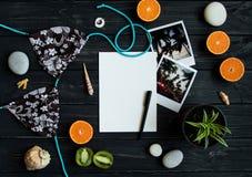 Holiday elements: photos, stones, seashells, fruits, travel photo. Flat lay, top view Royalty Free Stock Images