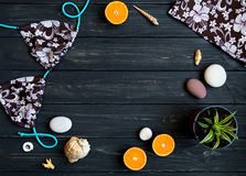 Holiday elements: swimsuit, stones, seashells, fruits. Travel photo, flat lay, top view stock photography