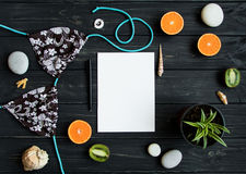 Holiday elements: swimsuit, stones, seashells, fruits. Travel photo, flat lay, top view Royalty Free Stock Photo
