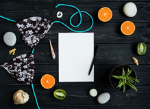 Holiday elements - swimsuit, stones, seashells, fruits. Travel photo, flat lay, top view stock images