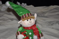 Holiday Elf. A holiday Elf bringing Christmas Joy on a blanket of snow in the middle of a Christmas Eve night stock photos