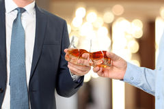 Holiday Event  business people cheering each other with Whisky Royalty Free Stock Photography