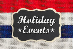 Holiday Events message. Holiday Events text on a chalkboard with red and blue stripes on burlap royalty free stock image