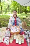 Beautiful curly bright original female seller of handmade marshmallows