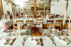 Banquet. festive table setting. Wedding table decorated with autumn flowers and candles stock images