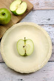 Holiday festive baking with an empty pie shell with apple Royalty Free Stock Photos