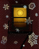 Holiday fire escape. Snowflakes falling in front of a decorated fire escape Stock Images