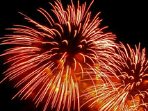 Holiday firework red-orange splashes Stock Photo