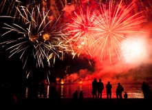 Holiday fireworks above water with reflection on the black sky background. Ok Royalty Free Stock Photo