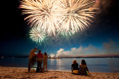 Holiday fireworks above water with reflection on the black sky background. Ok Royalty Free Stock Image