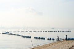 Holiday Fishing on Johor Strait Beach Royalty Free Stock Photo