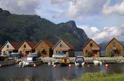 Holiday at the fjord. Holiday houses at the shore of a fjord in Norway Royalty Free Stock Photo