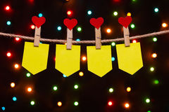 Holiday flags  with hearts. On the background of colored lights Stock Photos