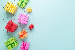 Holiday flat lay with colorful gift boxes. stock photos