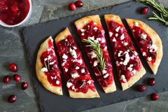 Holiday flatbread appetizer with cranberries and cheese, overhead scene Royalty Free Stock Photos
