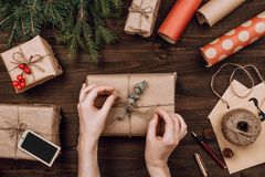 Holiday flatlay arrangement of wrapped presents. On dark wooden background royalty free stock photography