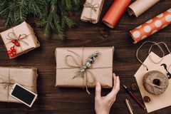 Holiday flatlay arrangement of wrapped presents. On dark wooden background royalty free stock photo