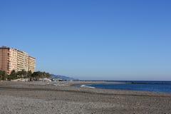 Holiday Flats Overlooking Pebble Beach ( Spain ) Stock Photo