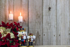 Holiday flowers, candles and nutcrackers royalty free stock image