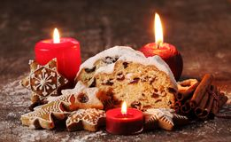 Holiday food. Christmas stollen, cookies and gingerbread royalty free stock photos