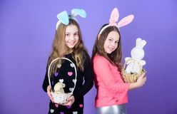 Holiday fun. Little children wearing bunny ears on Easter day. Girl children holding Easter rabbits in baskets. Small. Children with Easter bunny toys bringing stock images